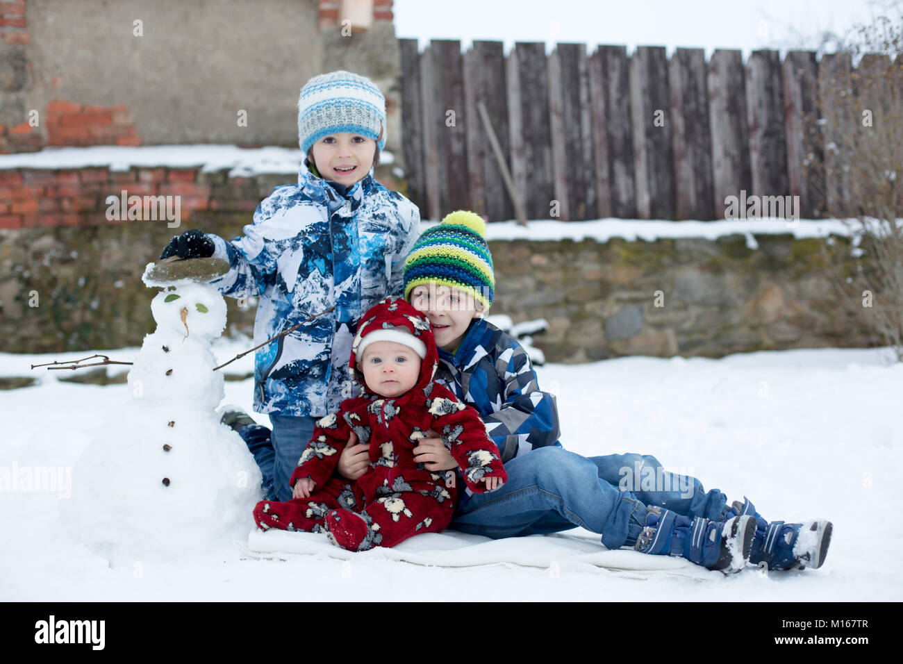 1104cf40a Little cute smiling baby boy and his two older brothers