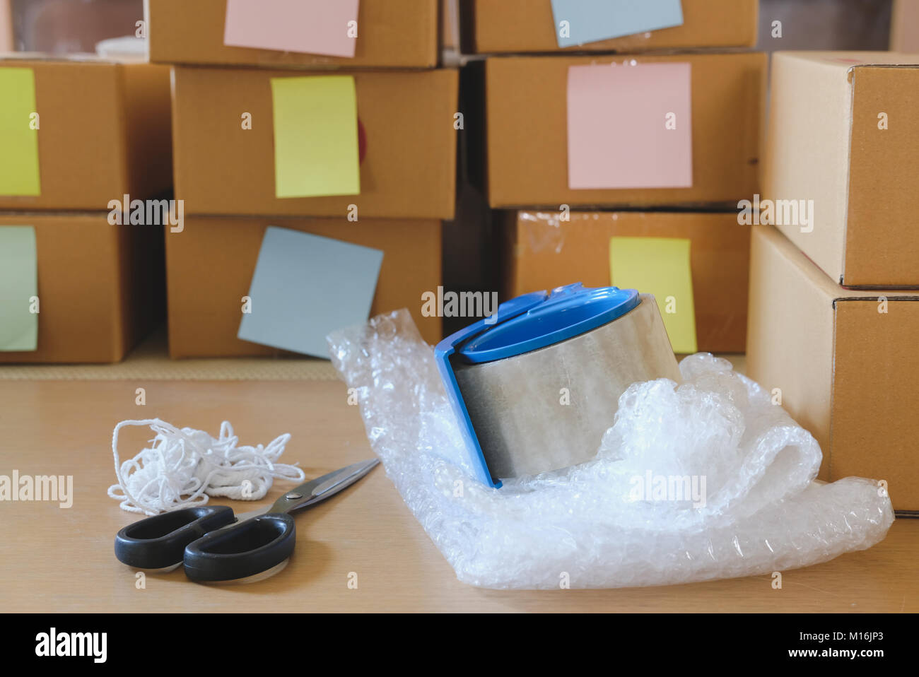 packing accessorie at workplace of startup small business owner