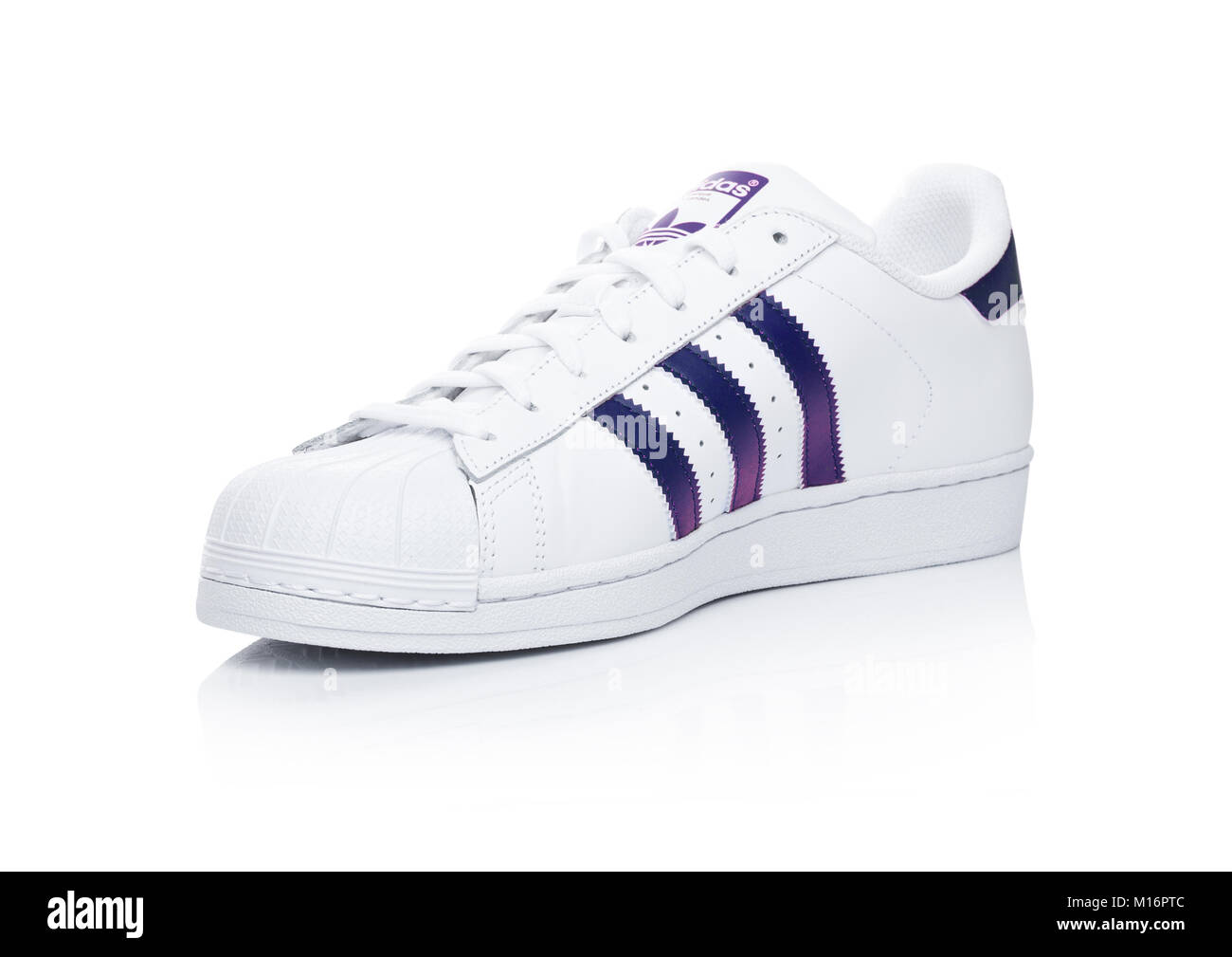 LONDON, UK - JANUARY 24, 2018: Adidas Originals Superstar blue shoes on white background.German multinational corporation that designs and manufacture