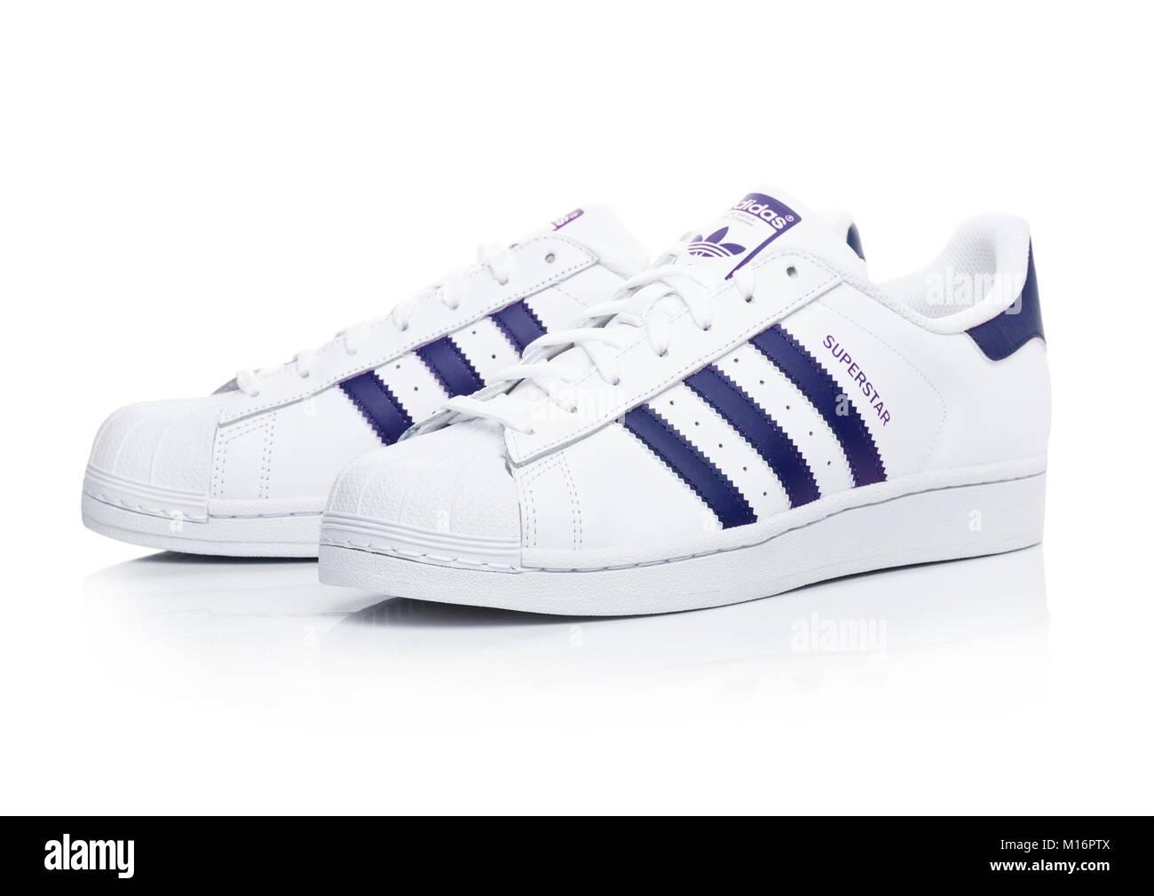 LONDON, UK - JANUARY 24, 2018: Adidas Originals Superstar blue shoes on  white