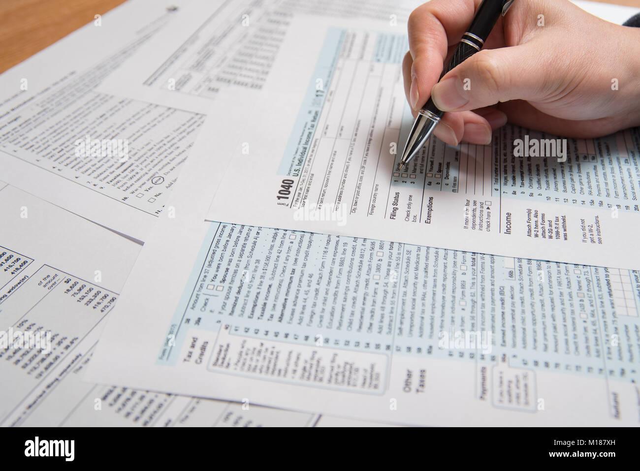 Usa Tax Form 1040 Man Filling Us Tax Form Stock Photo 172900185