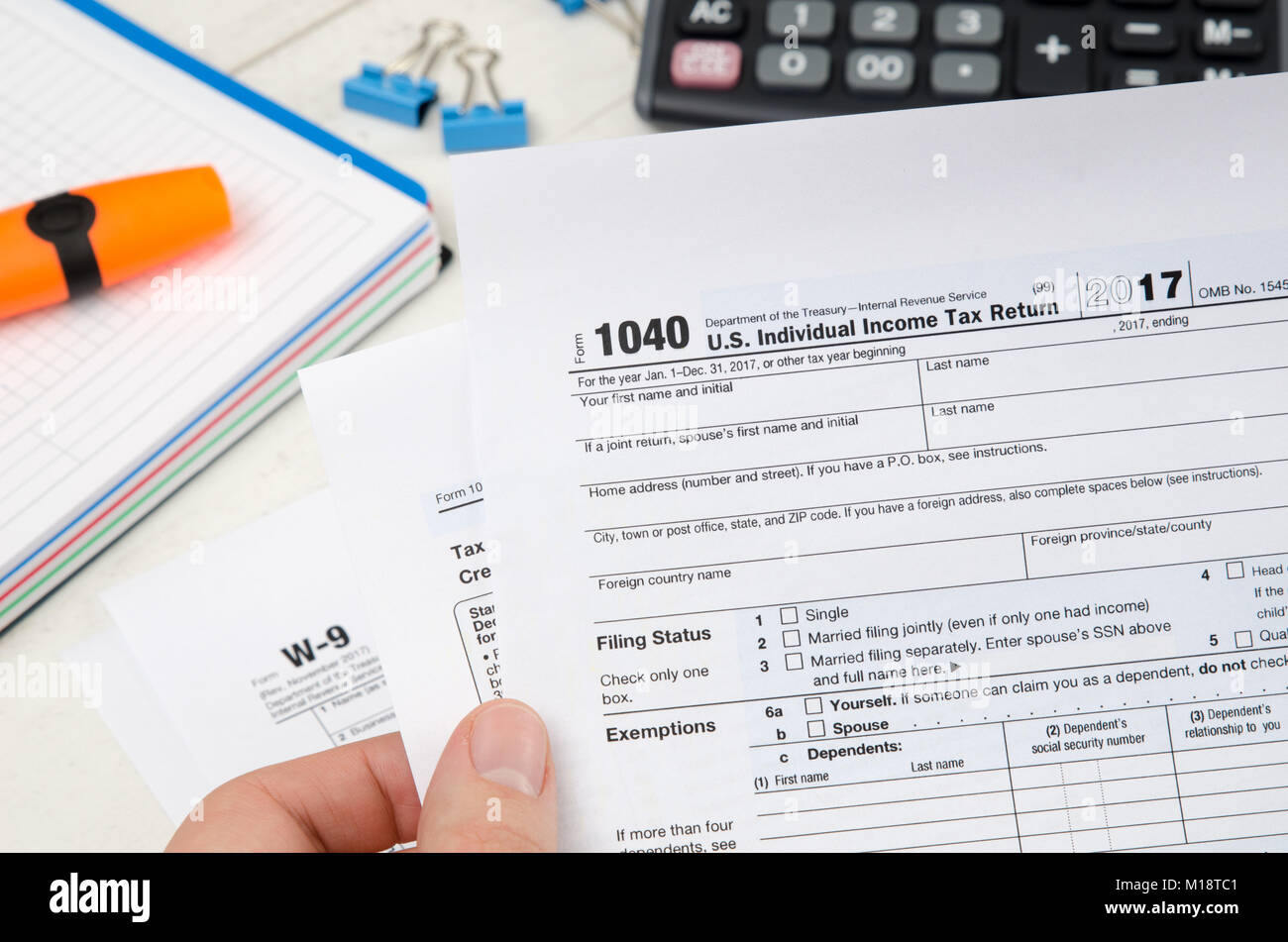 1040 tax form stock photos 1040 tax form stock images alamy man holding us tax form 1040 tax form law document irs business concept stock falaconquin