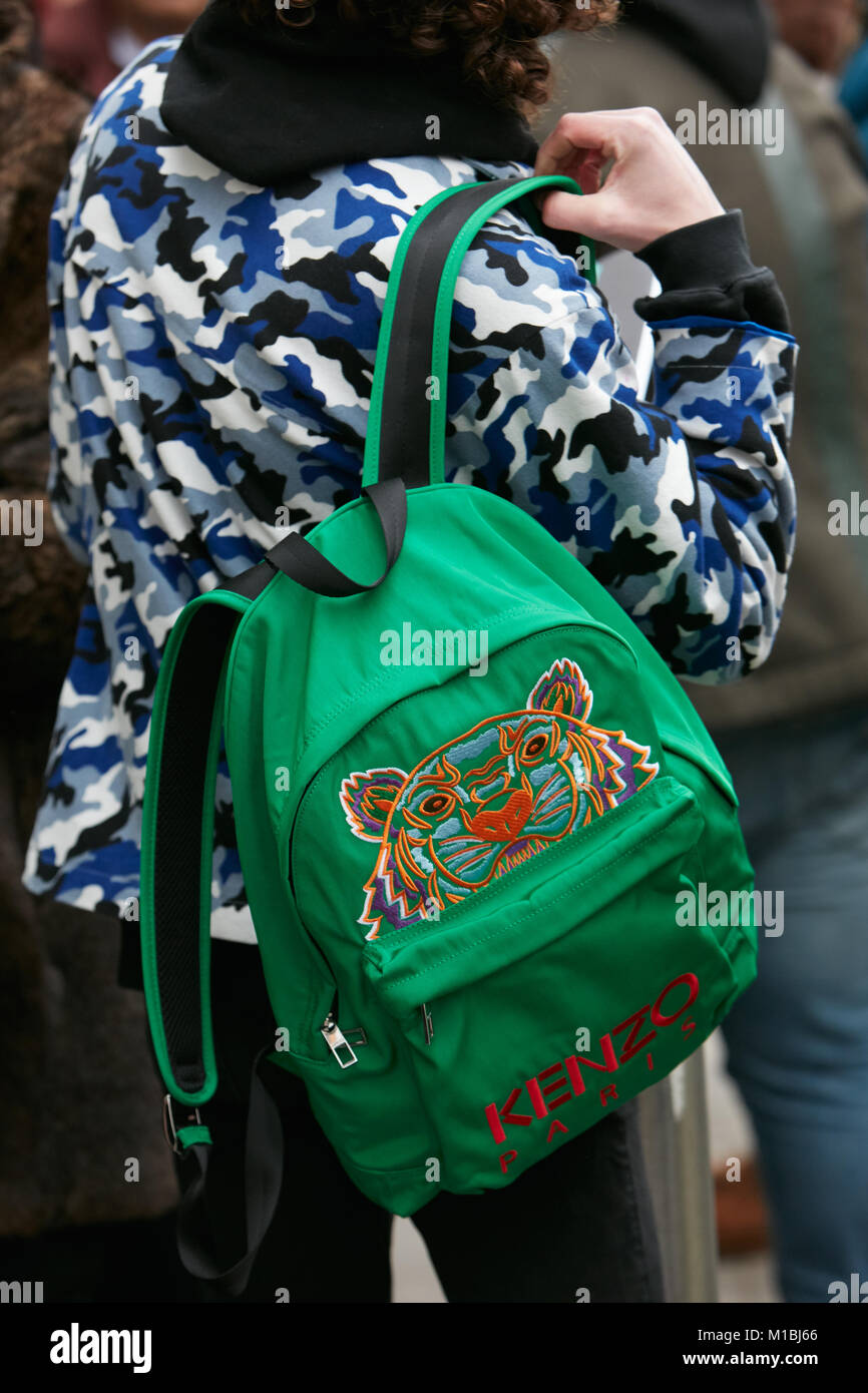 Milan January 15 Man With Green Kenzo Backpack Tiger And Bacpack Blue Camouflage Jacket Before Giorgio Armani Fashion Show Week Street