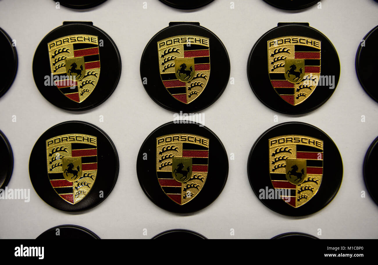 Logos Of The German Automobile Company Porsche Are Stored In Boxes