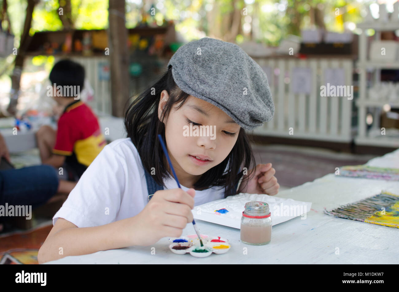 Kids asian Coloring Tray Coloring on the Table Stock Photo ...