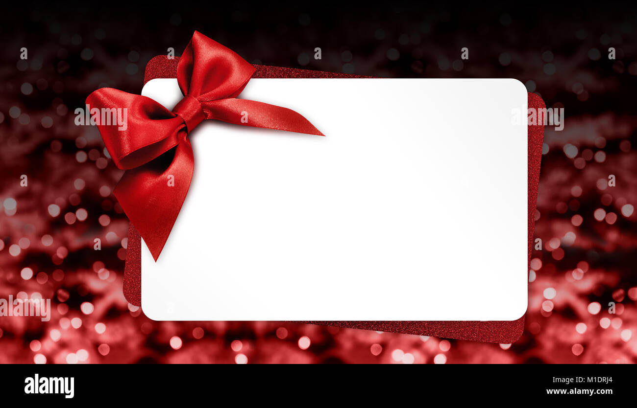 christmas gift card with red bow on blurred bright lights template