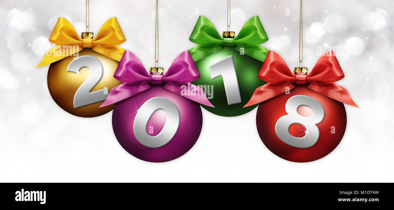 happy new year christmas balls with colored ribbon bow and 2018 text on silver blurred lights background
