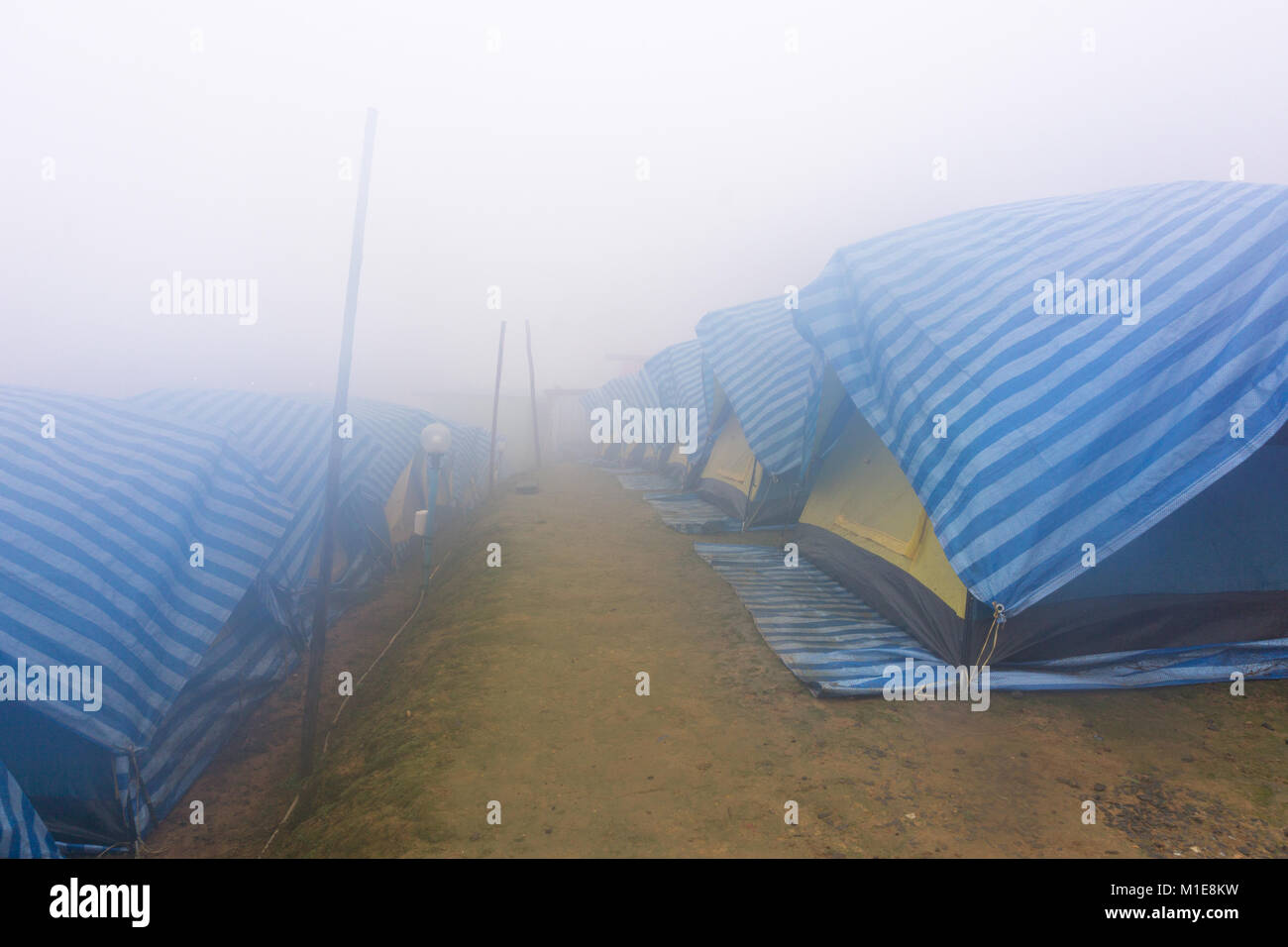tourist tent in mist and fog. Travel tent in the morning with fog & tourist tent in mist and fog. Travel tent in the morning with fog ...