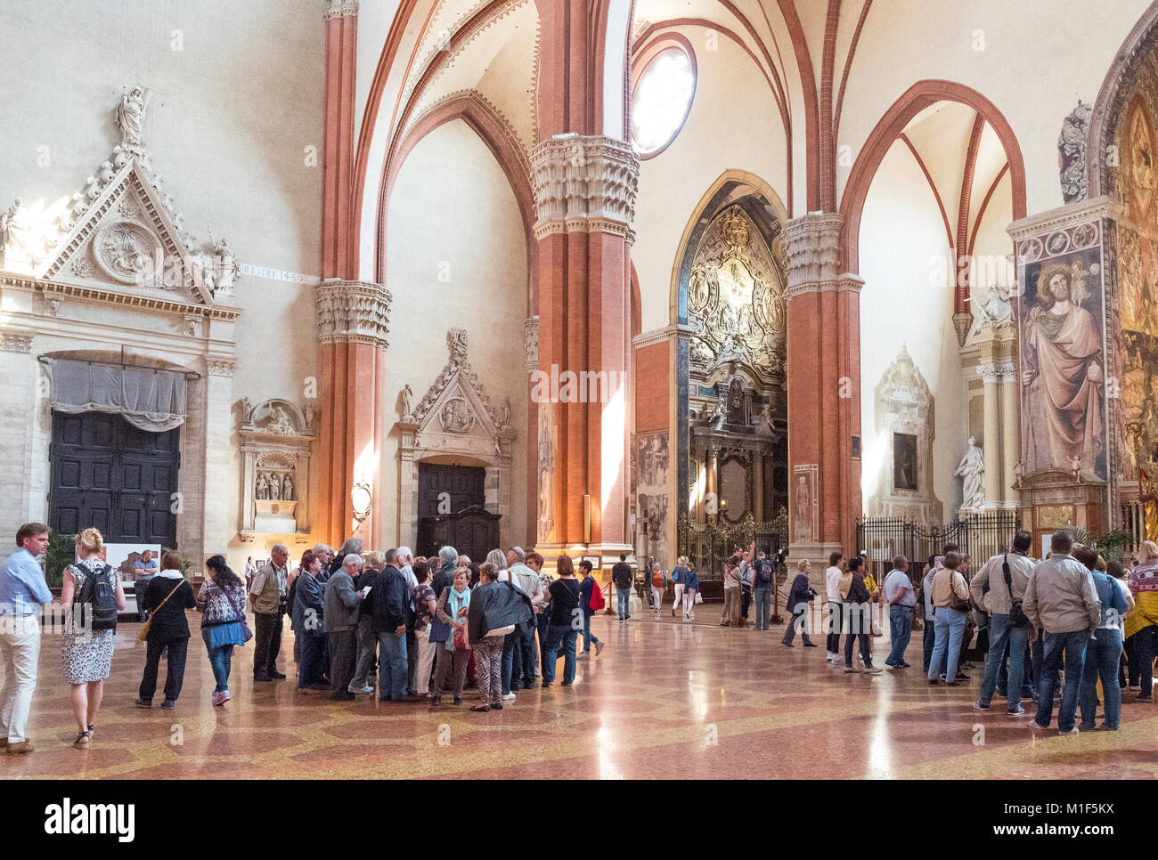 bologna italy a croud of visitors in the st petronio basilica
