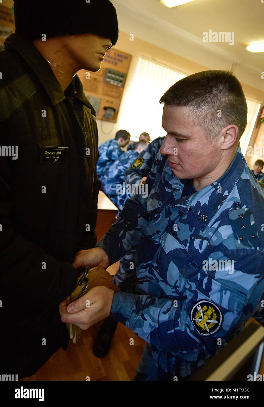 VLADIVOSTOK, RUSSIA - JANUARY 29, 2018: An employee of the Prisoner Escort  Service at the Main Directorate of the Russian Federal Penitentiary Service  seen ...
