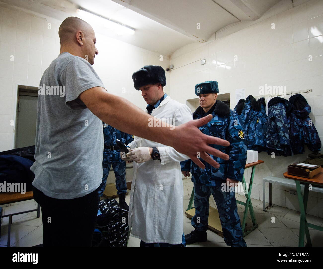 VLADIVOSTOK, RUSSIA - JANUARY 29, 2018: Employees of the Prisoner Escort  Service at the Main Directorate of the Russian Federal Penitentiary Service  examine ...