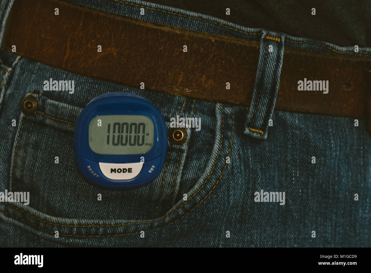 10,000 steps on a pedometer, attached to a pair of blue jeans