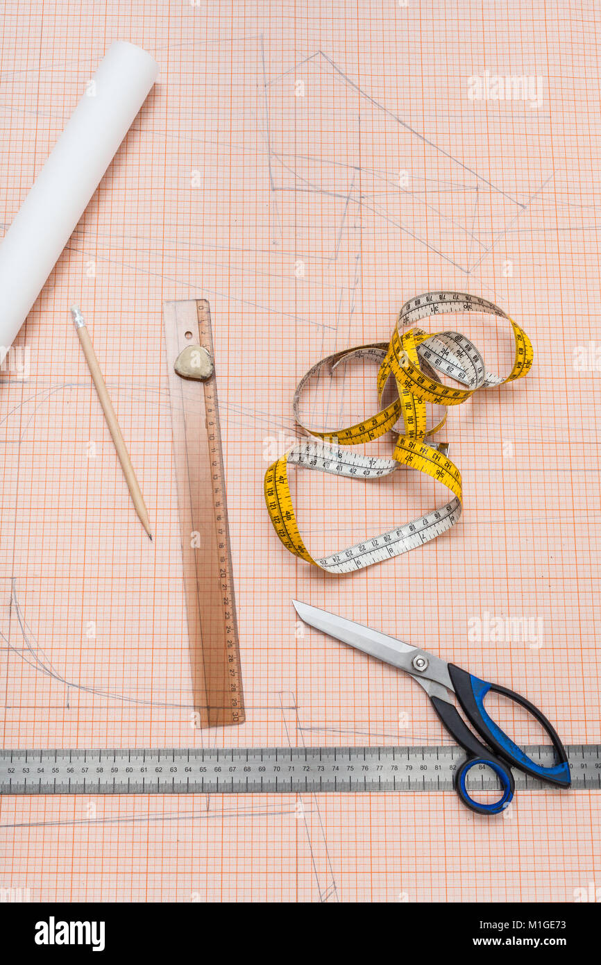 top view of items for clothing pattern draw on sheet of graph paper