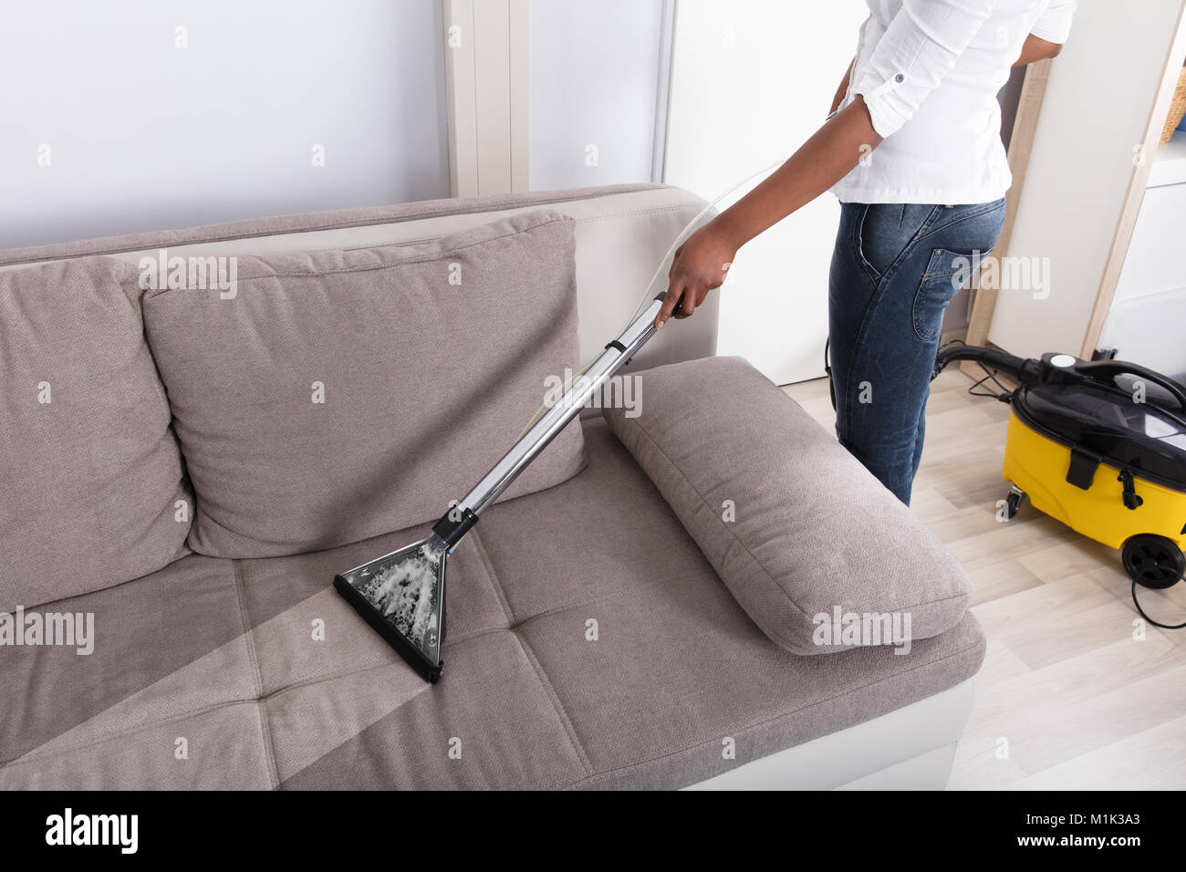 Housewifeu0027s Hand Cleaning Sofa With Vacuum Cleaner At Home