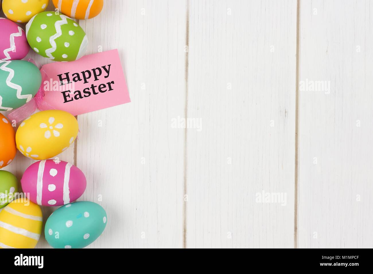 Happy easter gift tag with colorful easter egg side border against happy easter gift tag with colorful easter egg side border against a white wood background negle Image collections