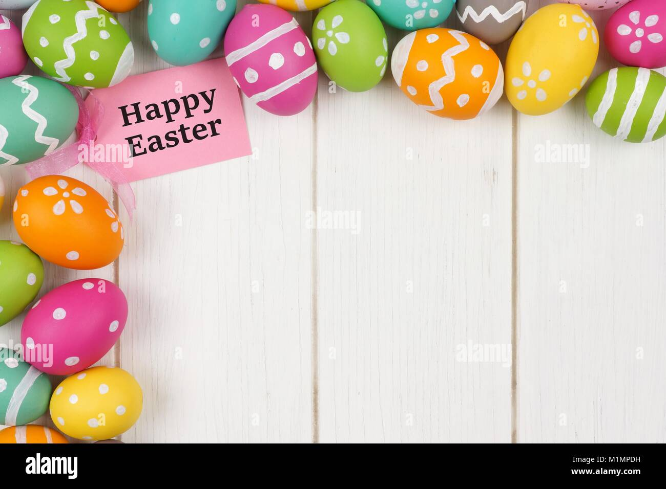 Happy easter gift tag with colorful easter egg corner border happy easter gift tag with colorful easter egg corner border against a white wood background negle Image collections
