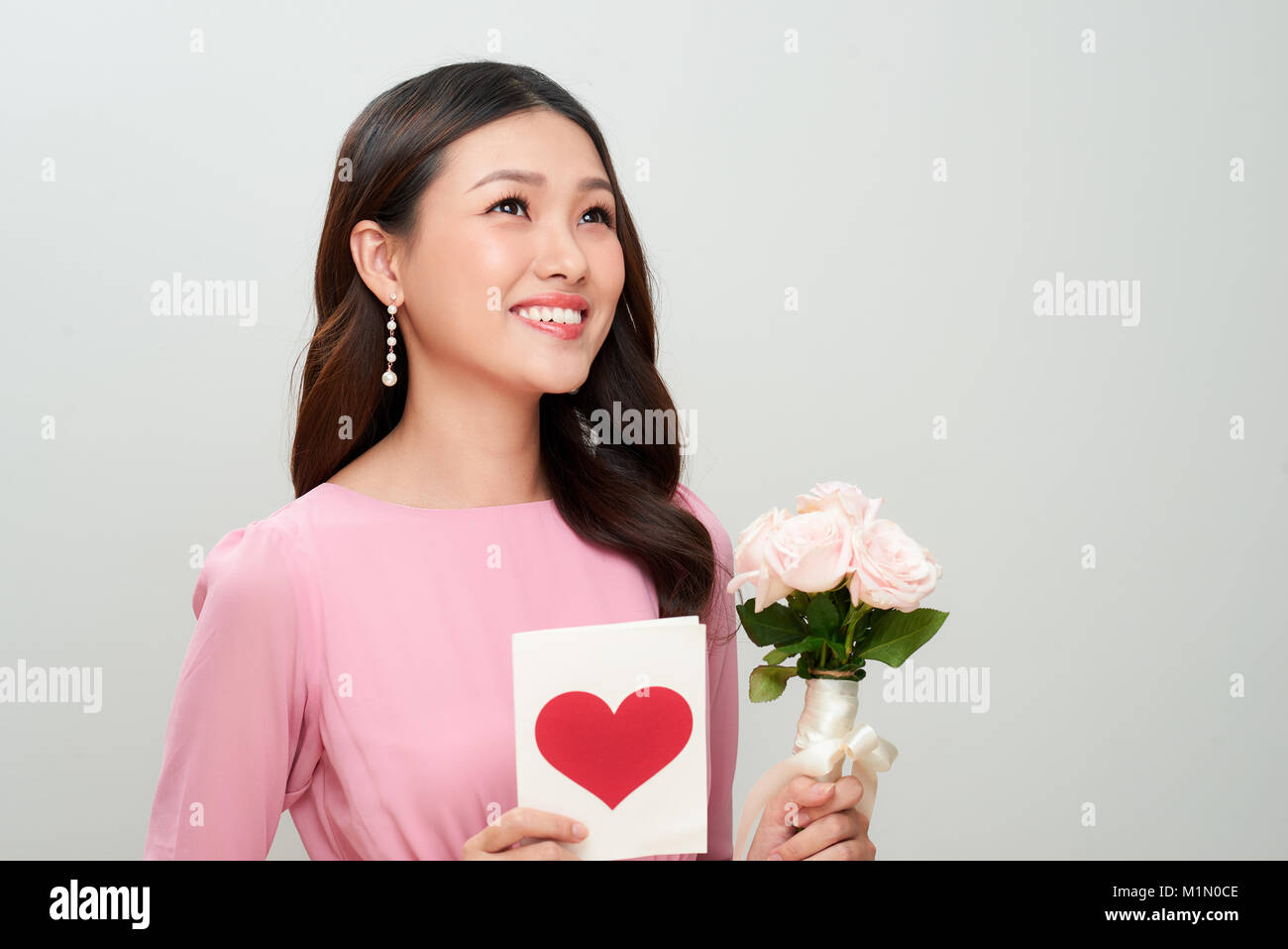 Beautiful girl with love letter and flowers happy woman day stock beautiful girl with love letter and flowers happy woman day izmirmasajfo