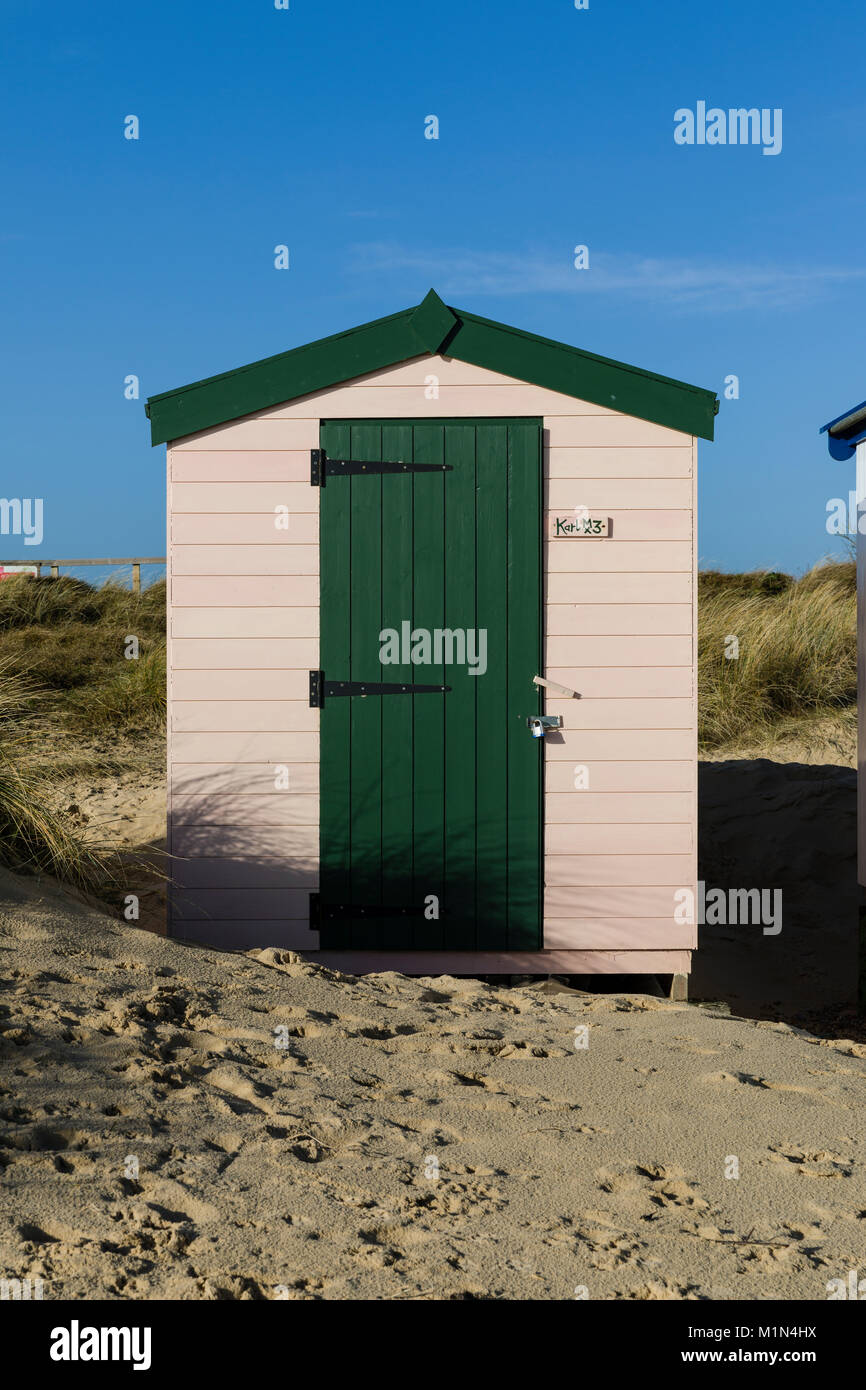 Traditional Wooden Beach Hut with crisp blue sky on Southwold Beach ...