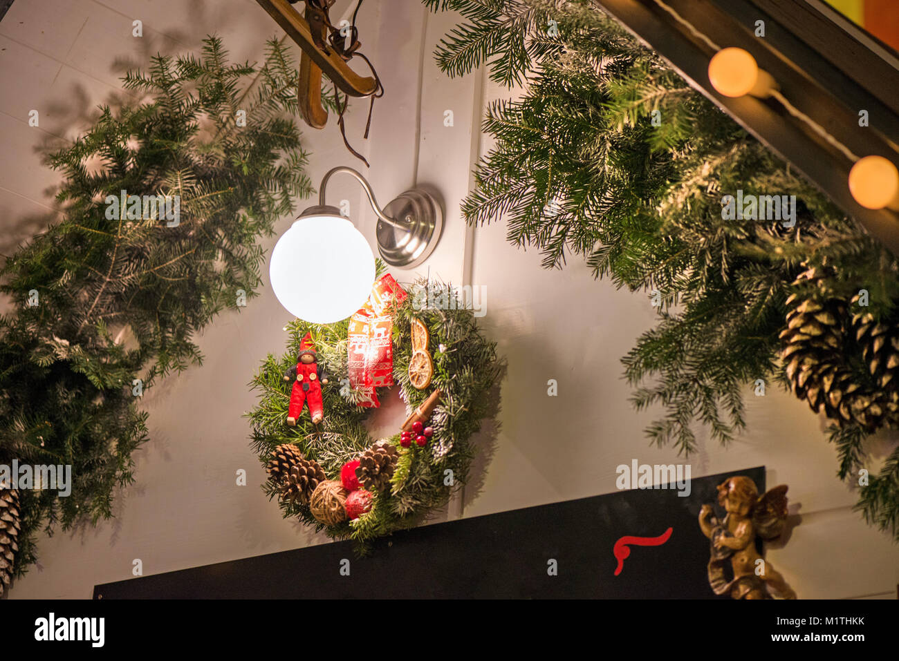beautiful christmas decorations hanging on doors outside the house green needle crown with pine cones angels dry fruits elf and red ribbons