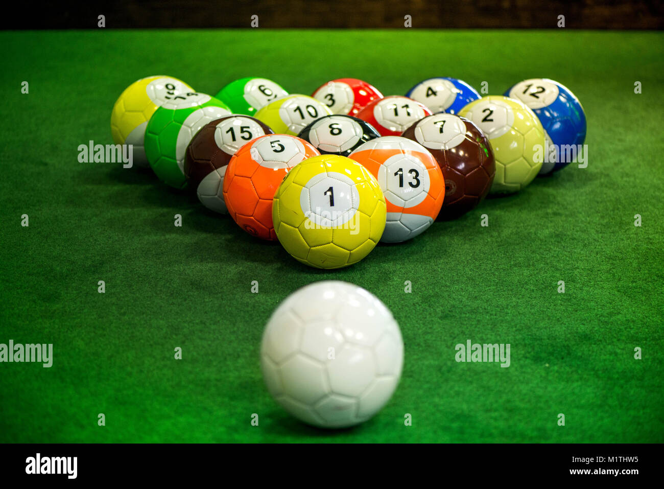 Shot Of Foot Pool Balls Standing On Green Table Foot Pool Is The - Big 5 pool table