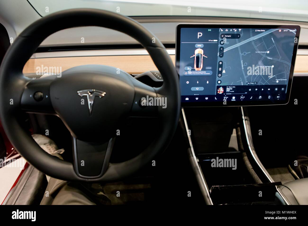 instead of a classic dashboard the model 3 comes with a center stock