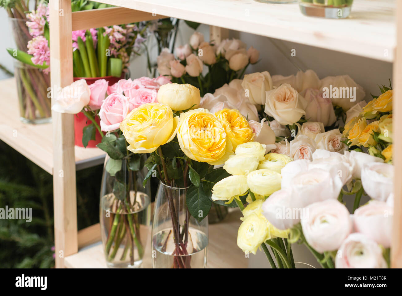 Flower shop concept. Different varieties fresh spring flowers in ...