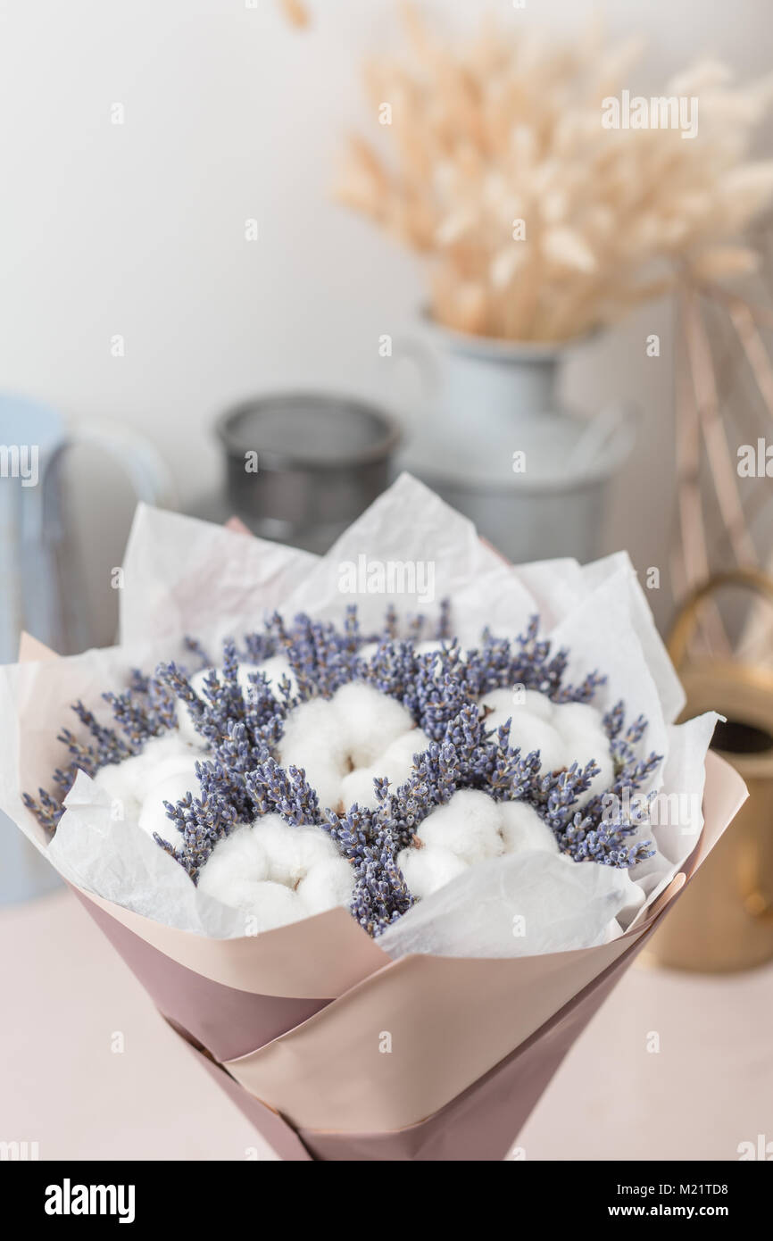 beautiful bouquet lavender and cotton, on table . dried flowers ...
