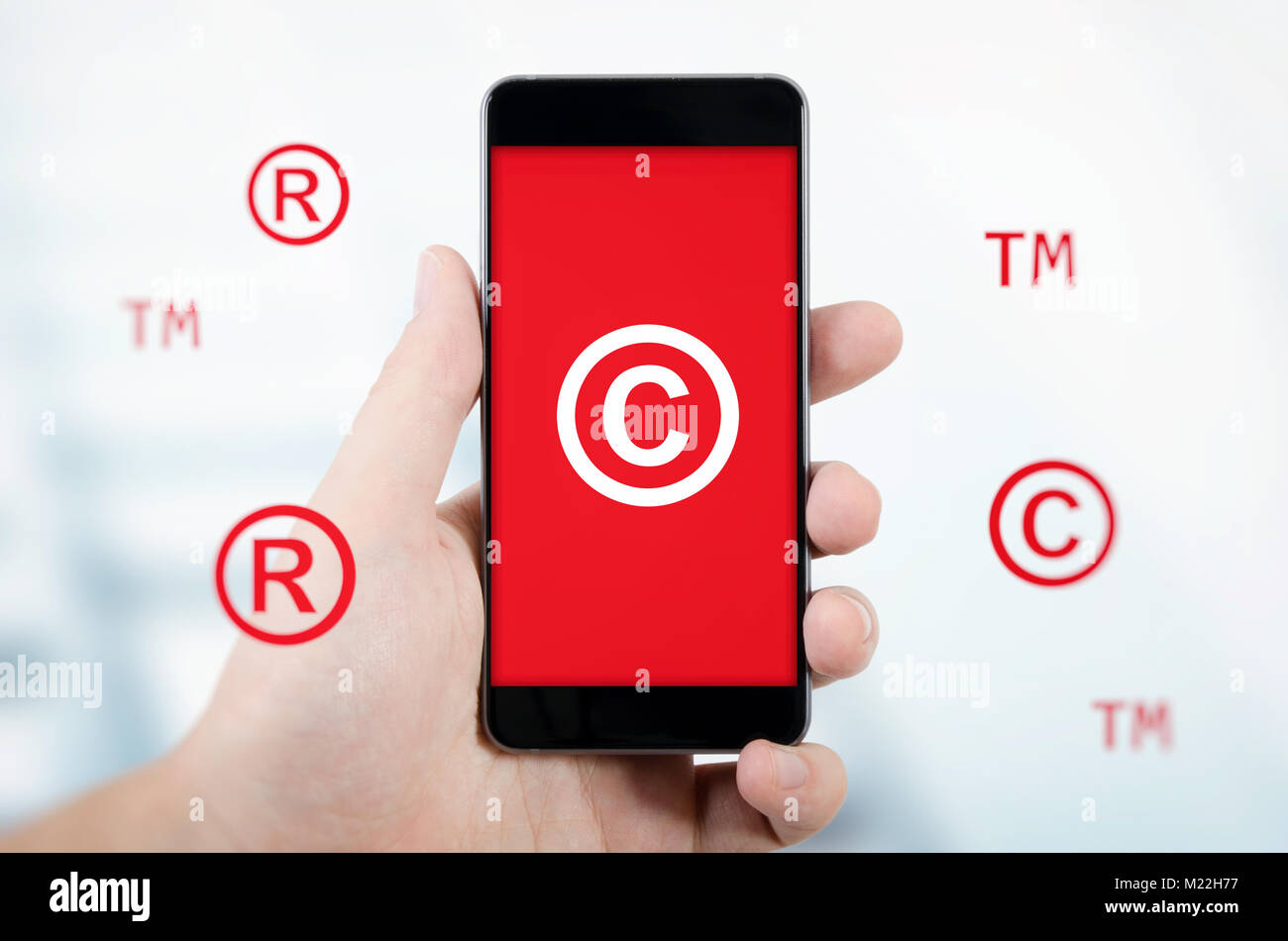 Trademark symbols stock photos trademark symbols stock images copyright trademark symbols flying around smartphone security and piracy composition stock image biocorpaavc