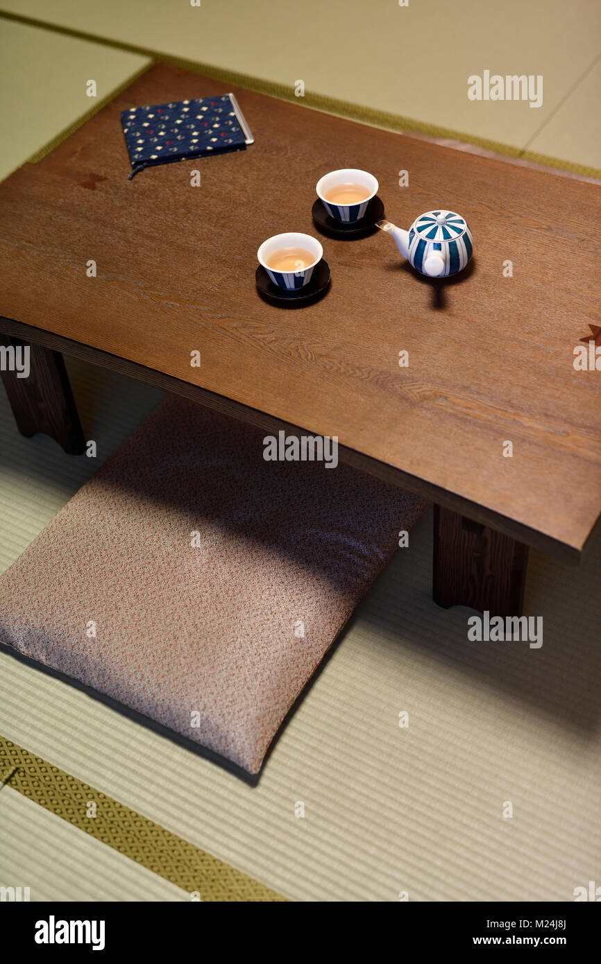 japanese short legged wooden tea table chabudai with a teapot and