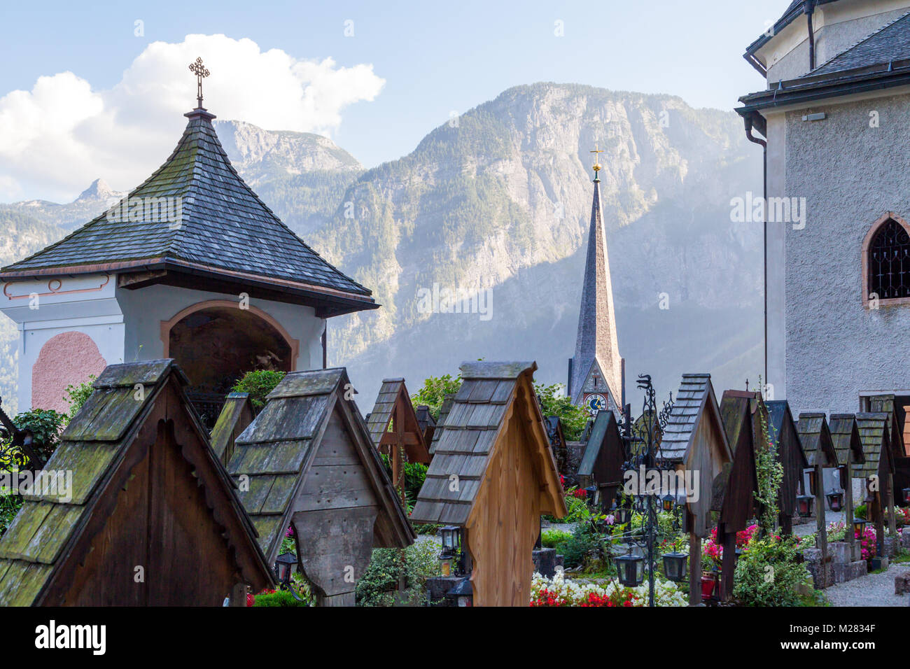 Landscape Hallstatt Village View From Beinhaus Ossuary Garden, Also Known  As Bone House, With Historical Iconic Mountain Houses Among High Alp Mountai