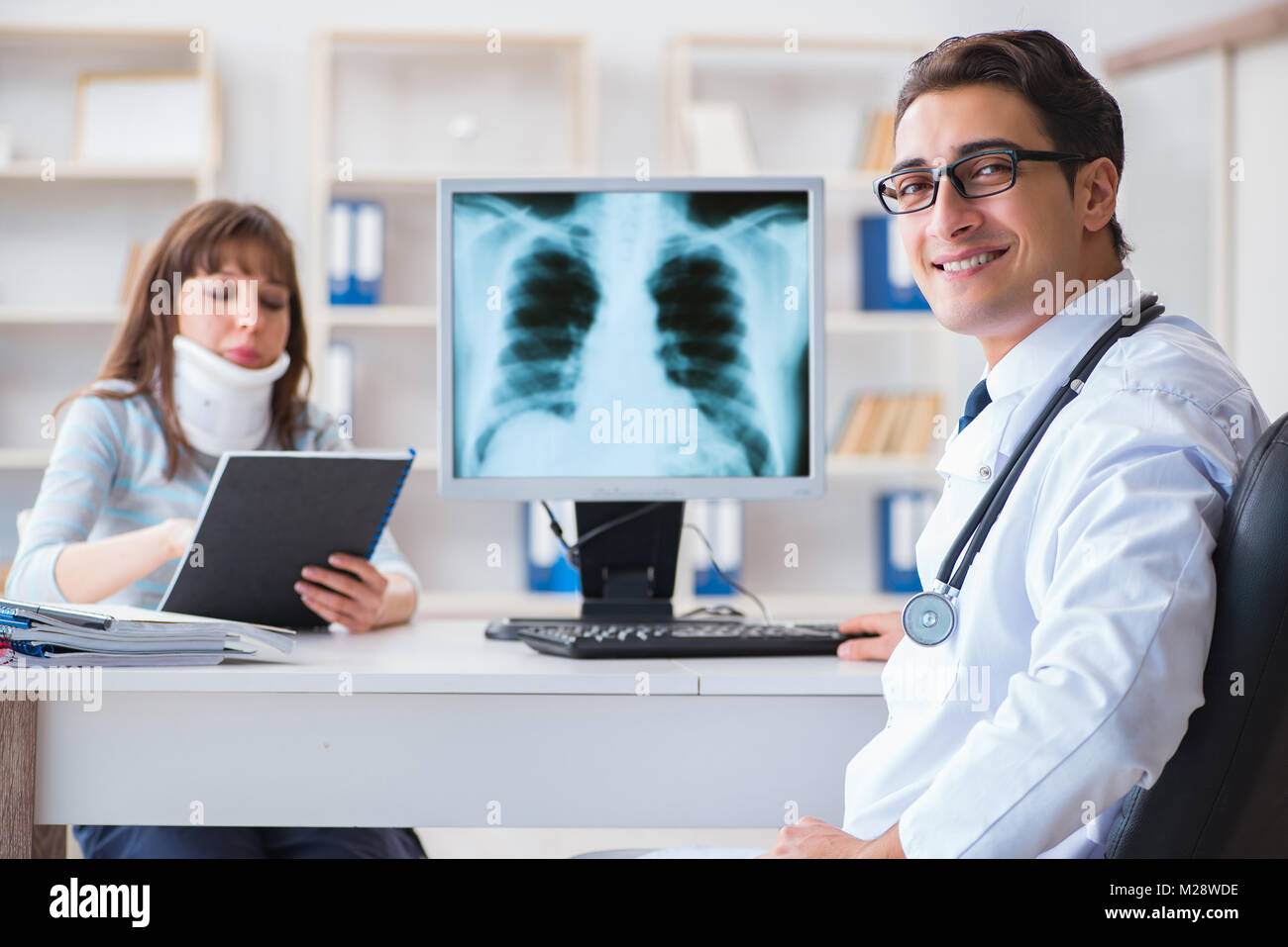 Young Woman Visiting Radiologist For X Ray Exam Stock Photo