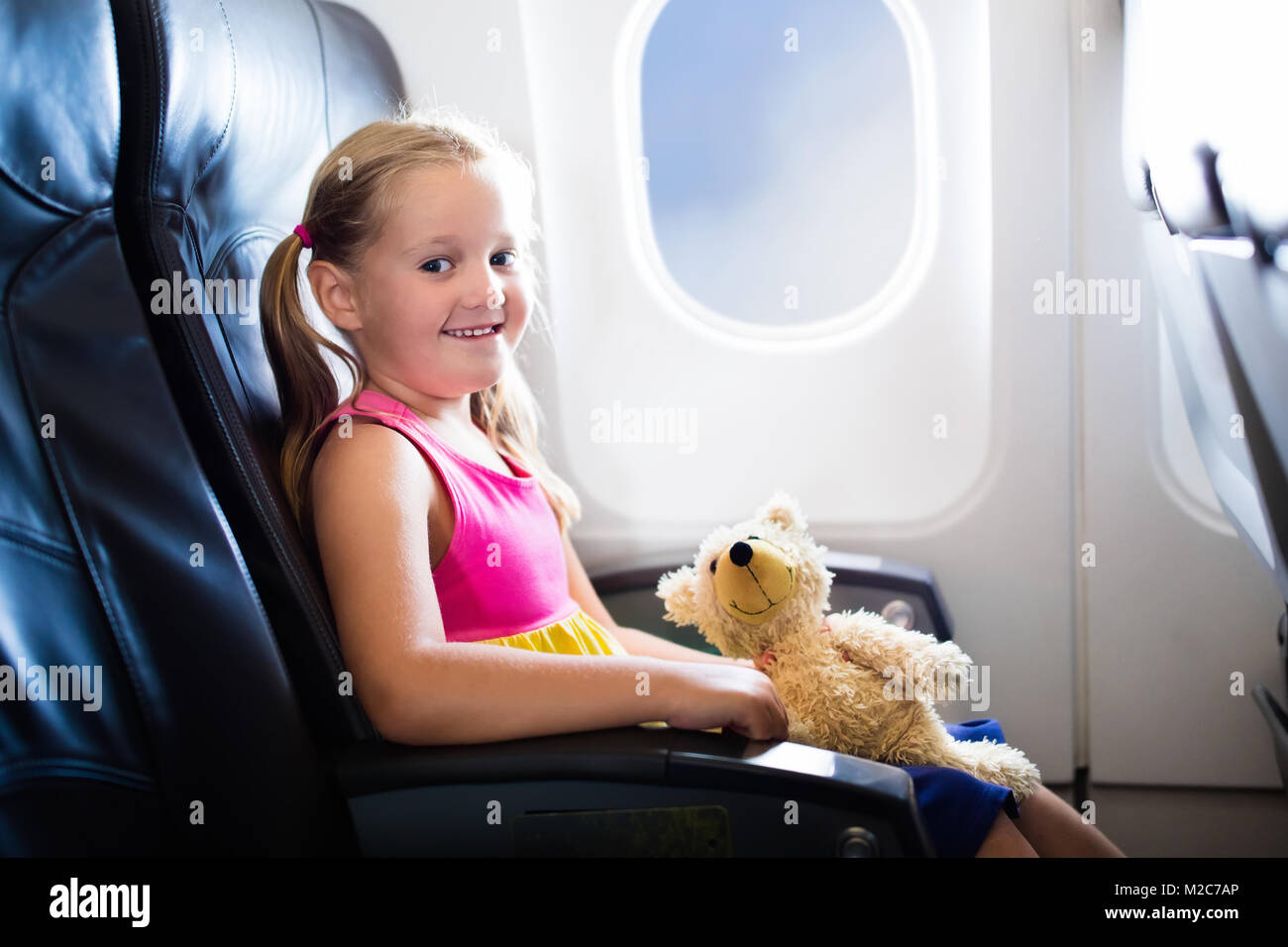 Child In Airplane Kid Air Plane Sitting Window Seat Flight Entertainment For Kids Traveling With Young Children Fly And Travel Family