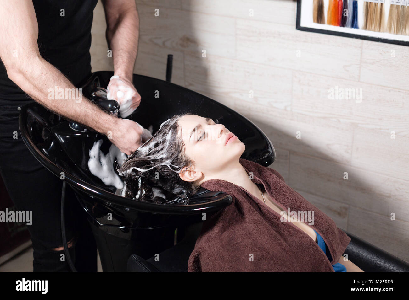Beautiful Girl Washes Her Hair Before A Haircut In A Beauty Salon