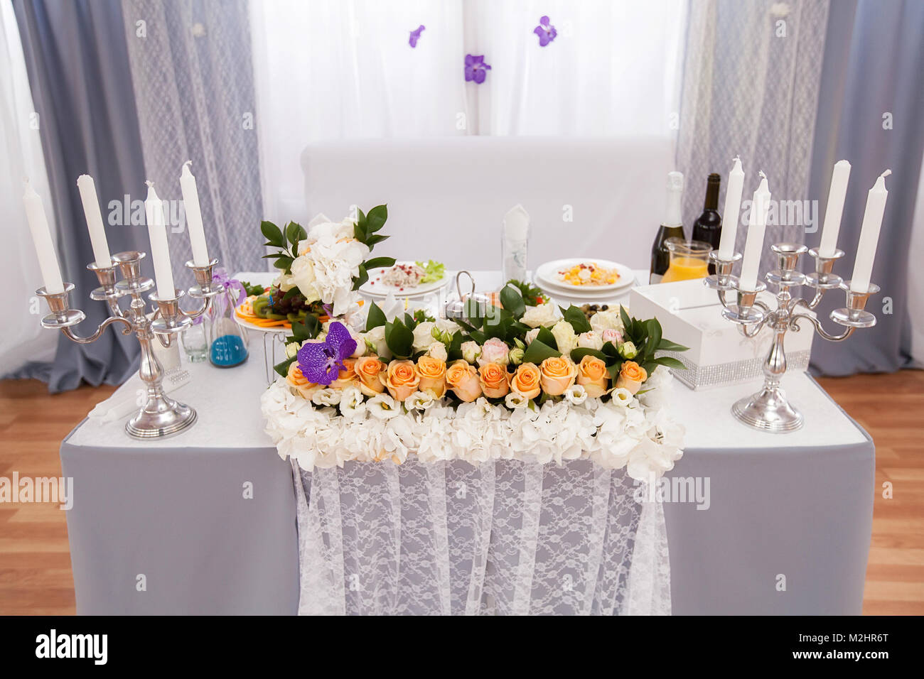 Wedding Banquet Table Decorated With Flowers And Serving In The - Banquet table setup ideas