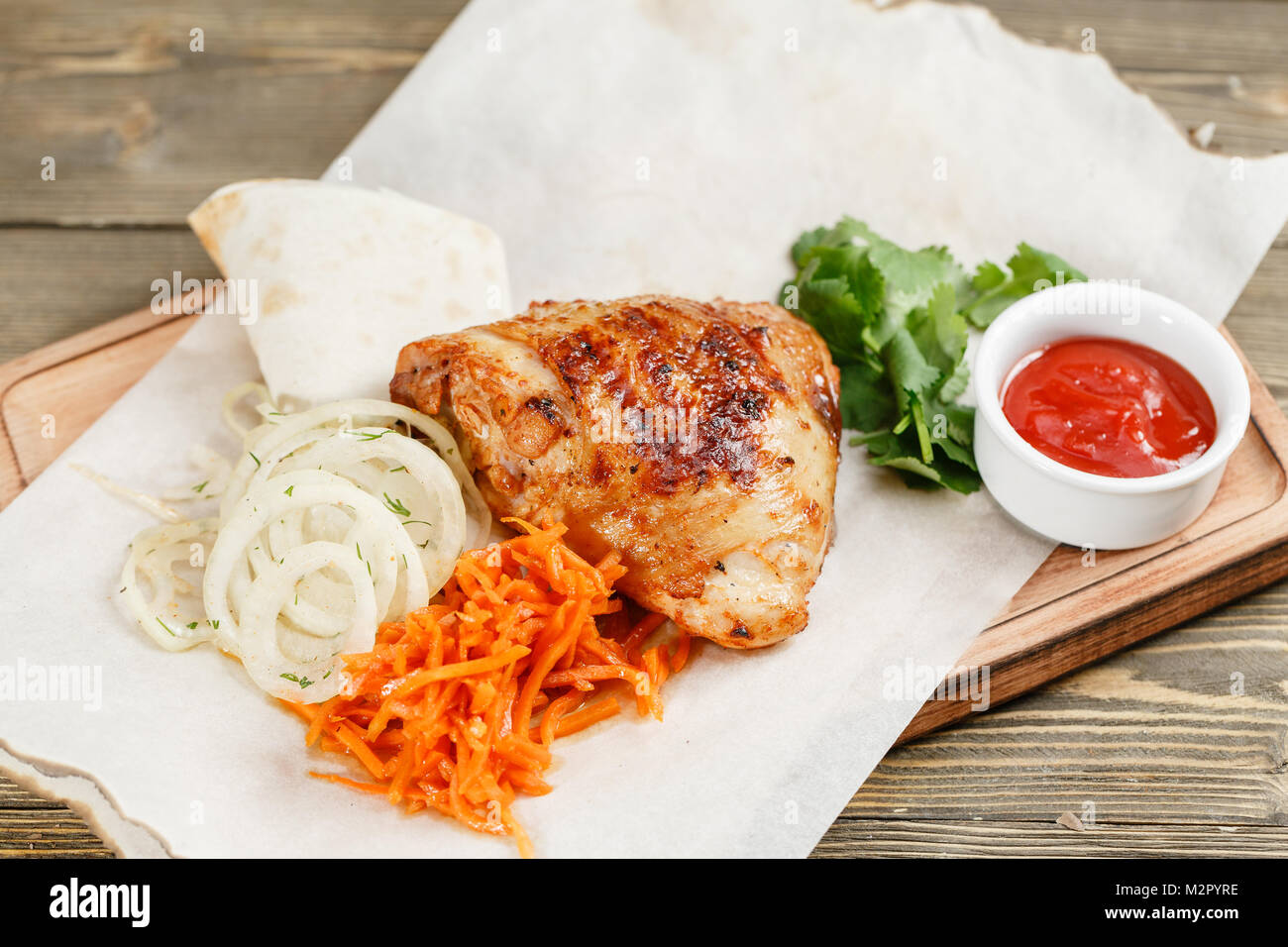 Grilled Chicken Serving On A Wooden Board On A Rustic Table Stock