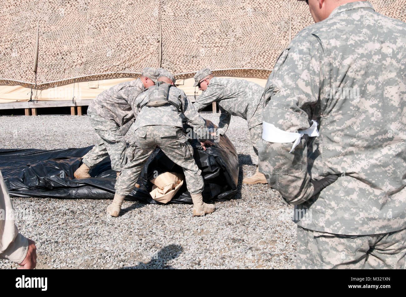 Soldiers of the 542nd Quartermaster Company unroll an air-supported tent to set up as & Soldiers of the 542nd Quartermaster Company unroll an air ...