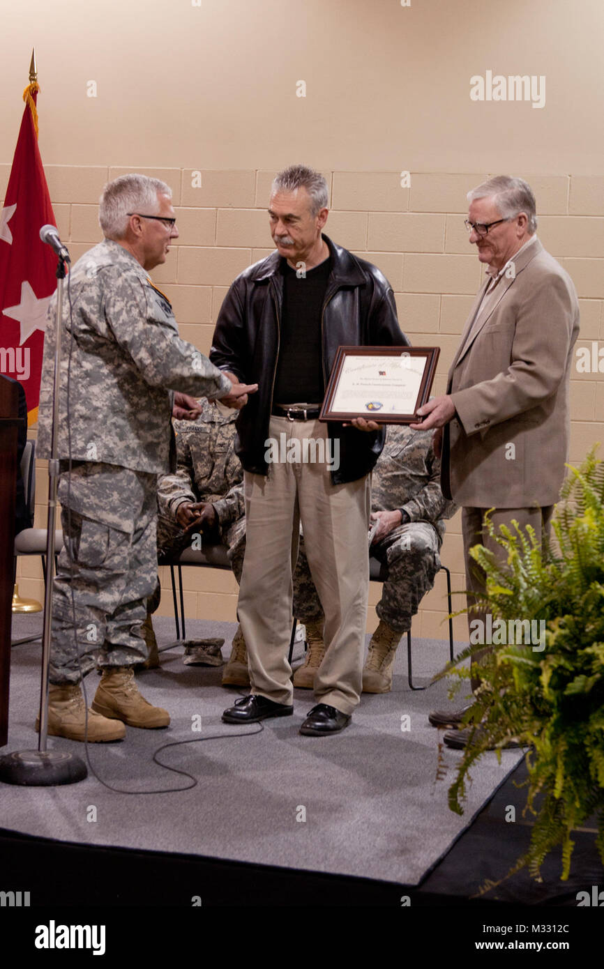 Maj gen myles deering the adjutant general for oklahoma myles deering the adjutant general for oklahoma presents a certificate of appreciation d h french construction company during a rededication ceremony yadclub Images