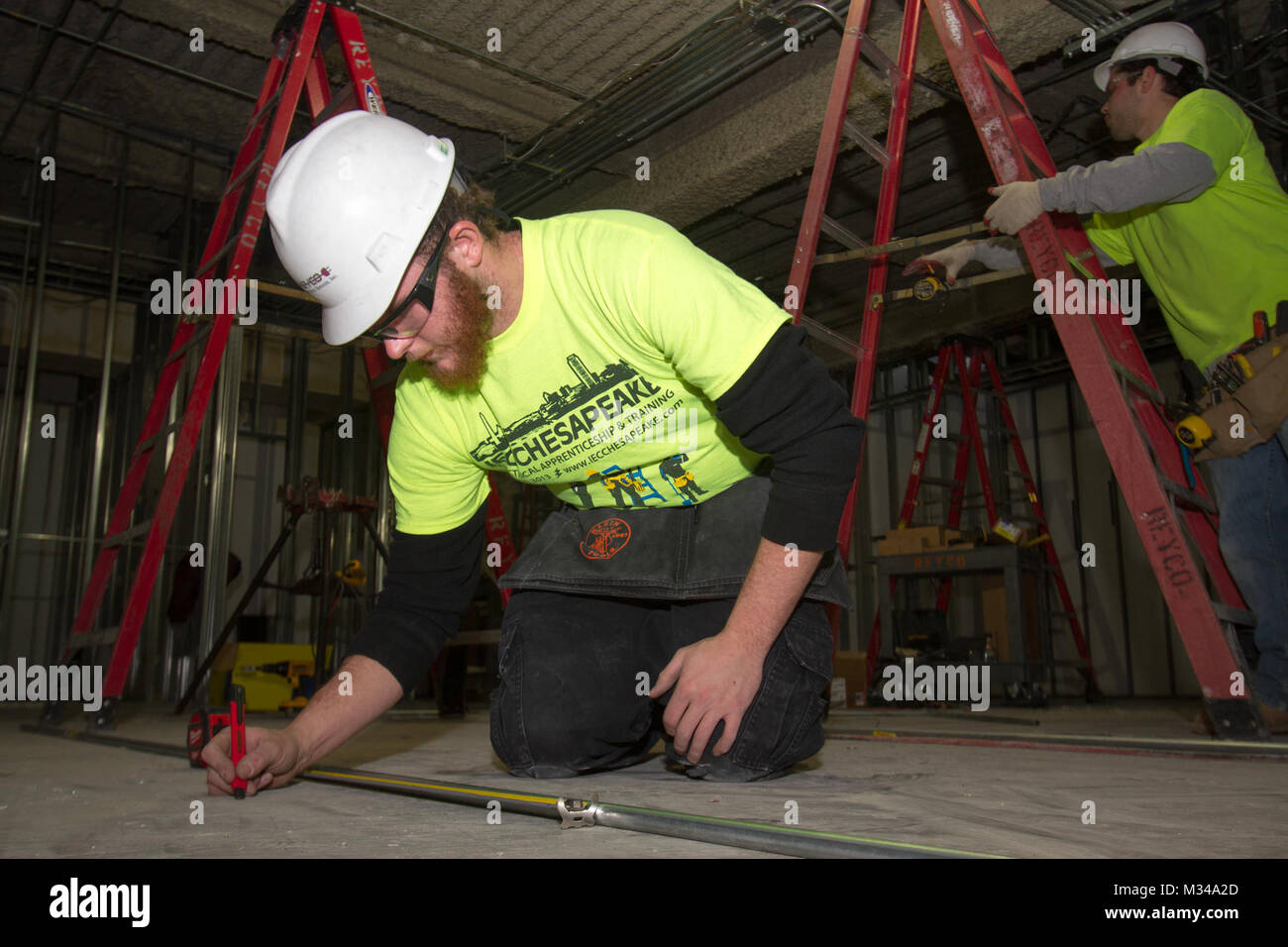 Chris Jameson An Electrical Apprentice Measures And Bends Conduit With How To Bend Together As Part Of The Renovations Arlington National Cemeterys Welcome Center