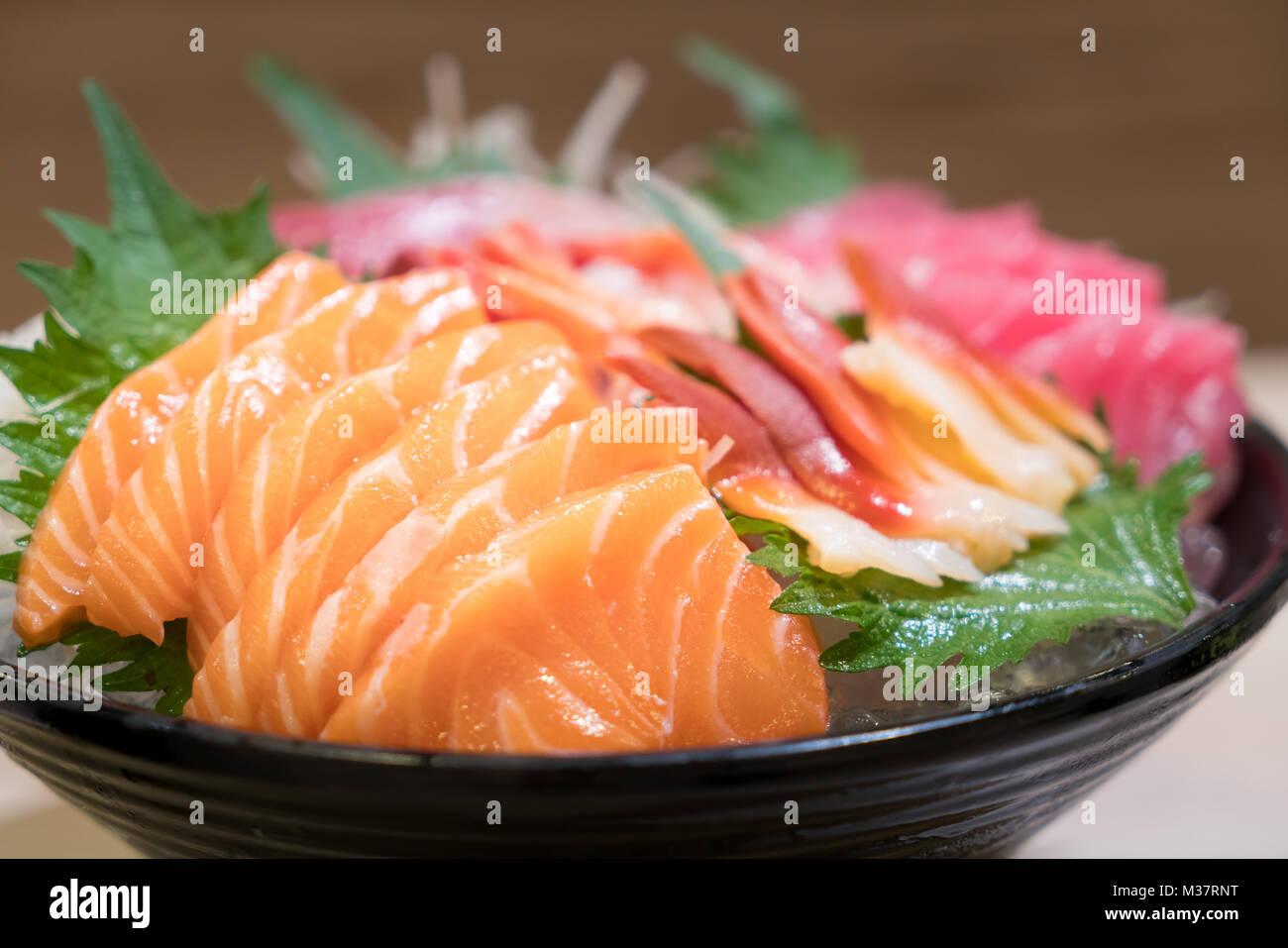 Mixed Sliced Fish Sashimi On Ice In Black Bowl Sashimi Salmon Tuna