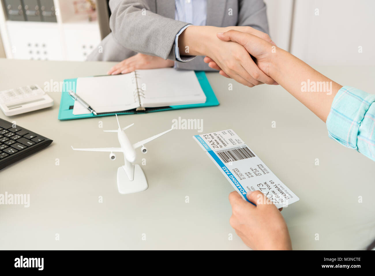 close up of travel agent company office worker with traveler