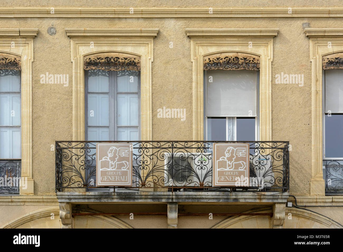 Traditional building facade with an ironwork balcony in Marciac ...