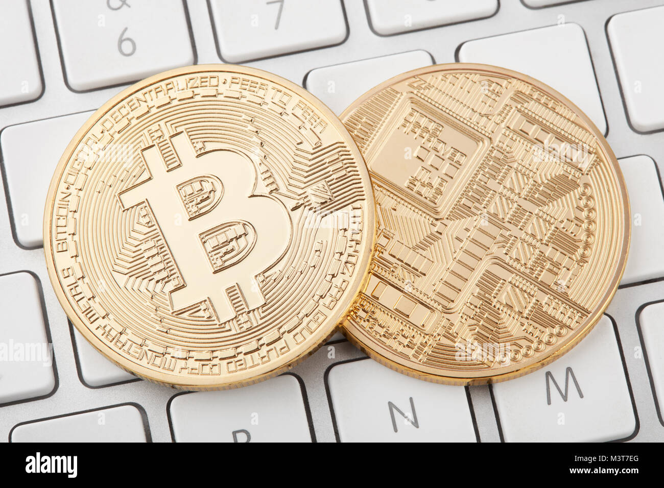 Two golden bitcoin front and back on computer keyboard stock photo two golden bitcoin front and back on computer keyboard ccuart Images