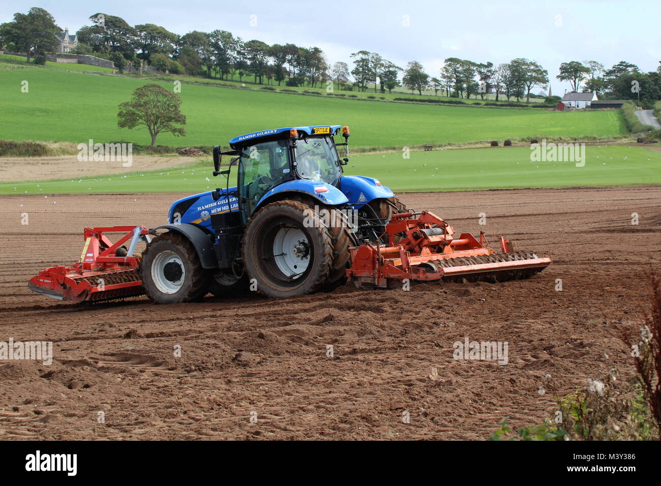 New Holland Tractor Bedding : Bed tilling stock photos images alamy