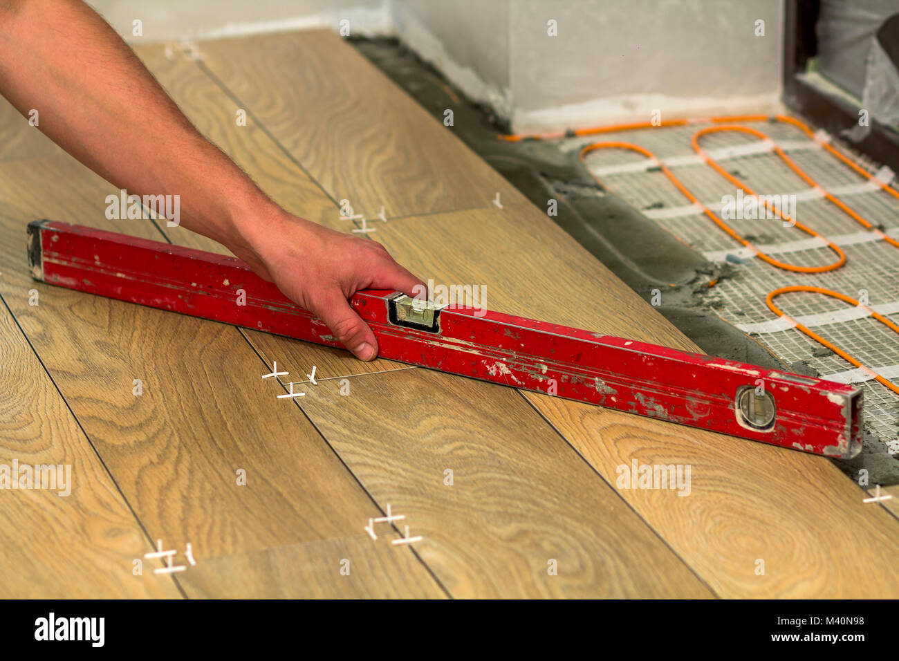 Heated floors stock photos heated floors stock images alamy installation of ceramic tiles and heating elements in warm tile floor renovation and improvement concept dailygadgetfo Images