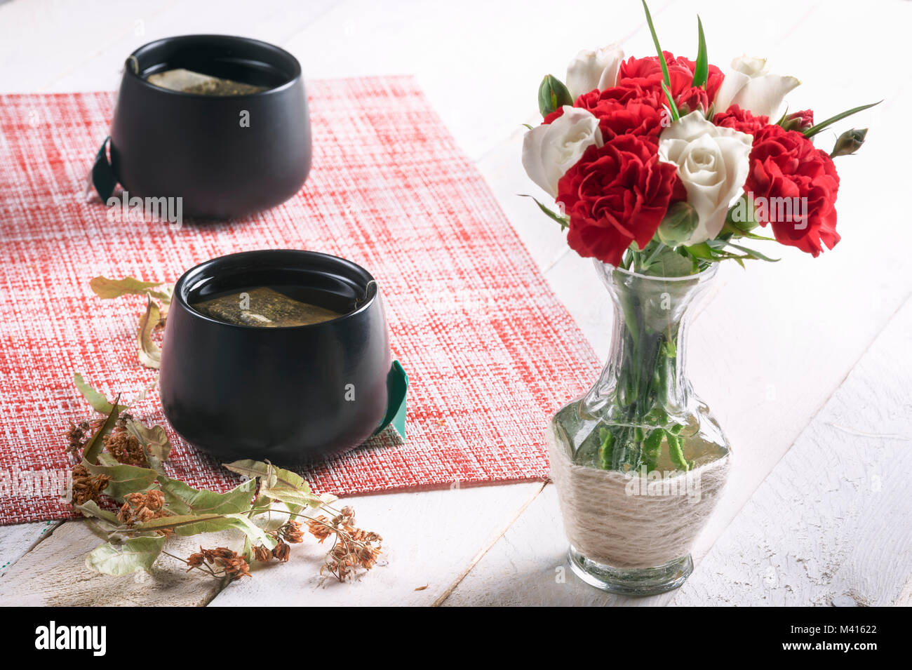 Bouquet roses in black vase stock photos bouquet roses in black bouquet of white roses and red carnations in a cute vase and two black cups of reviewsmspy