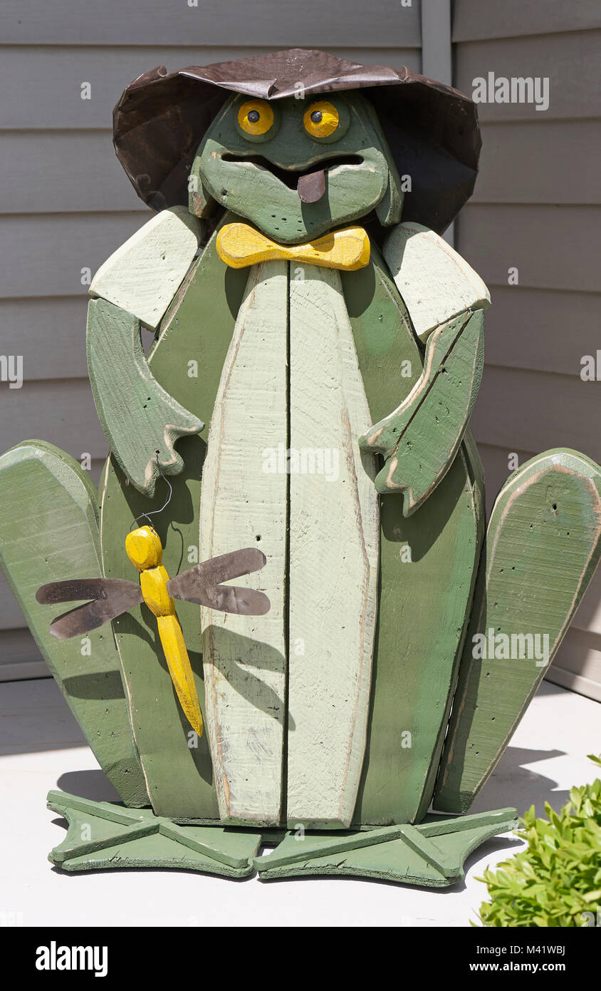 Wooden green frog for lawn and garden decorations Stock Photo ...