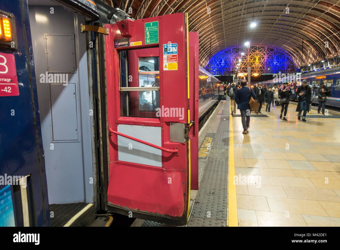 Old fashioned slam doors open on a train taking on passengers at Padding Railway Station in London UK & Old fashioned slam doors open on a train taking on passengers at ...