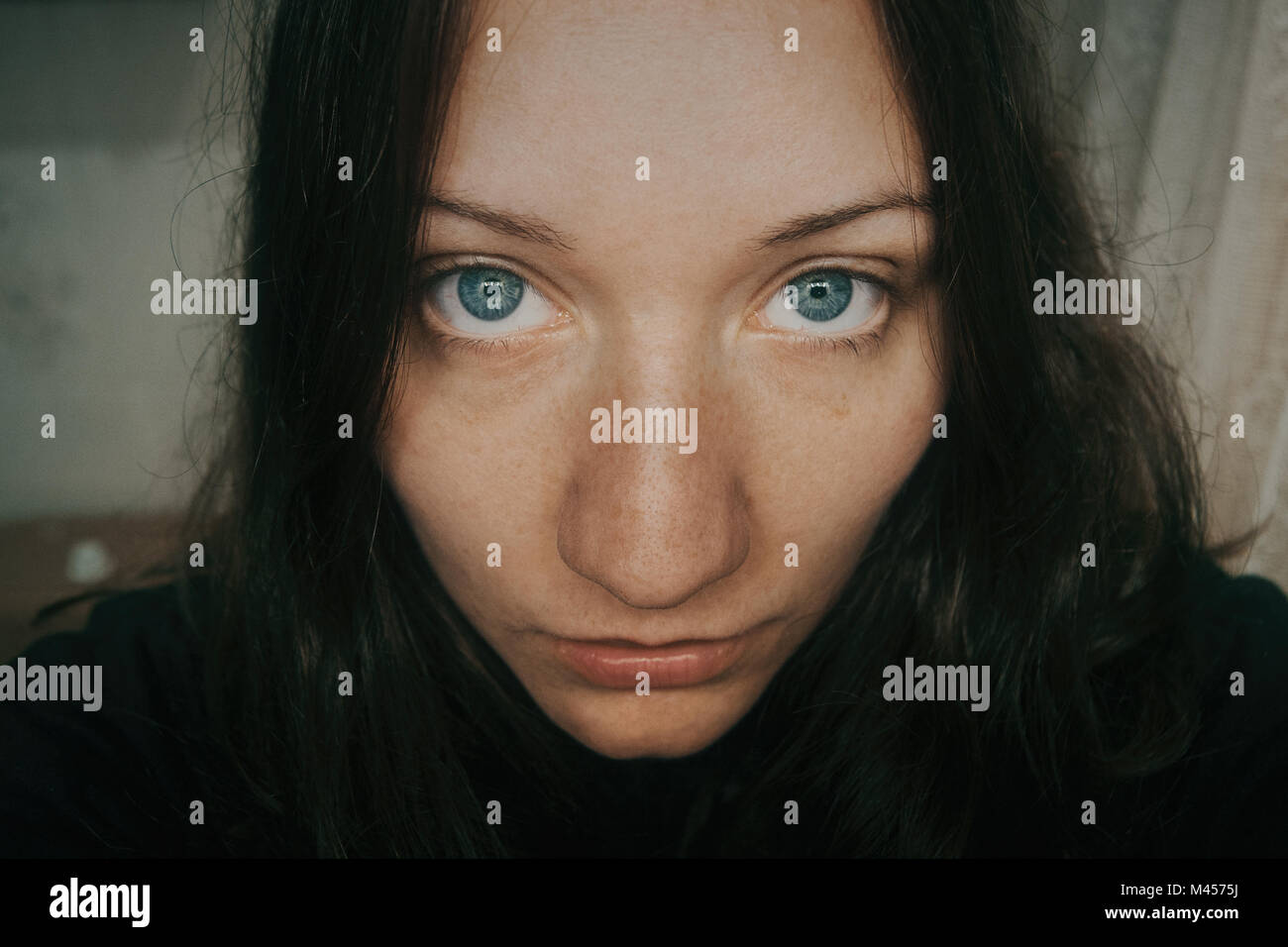 Big Blue Eyes Of Girl Looking At Camera Stock Photo 174677710 Alamy