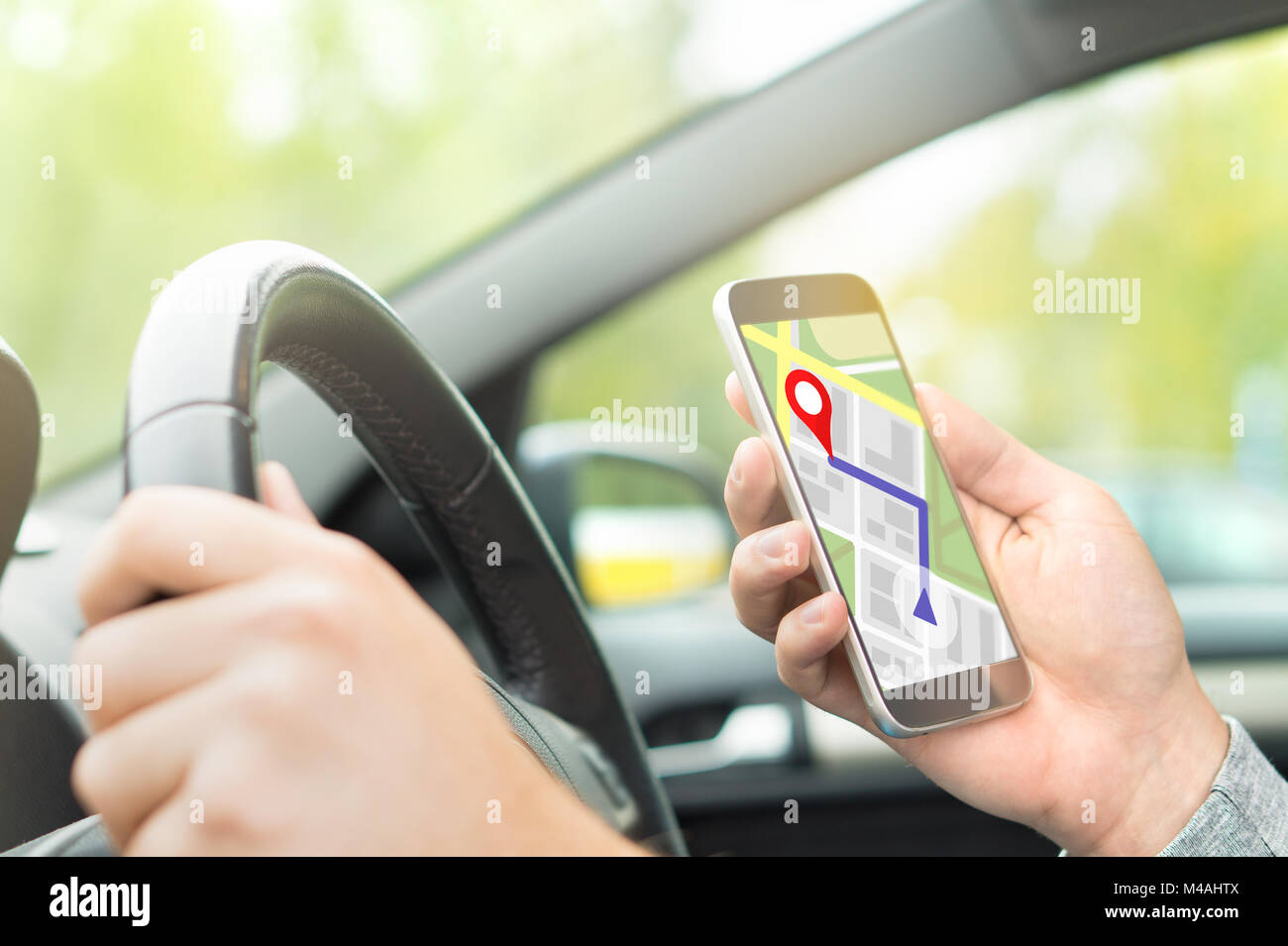 Man Driving Car And Using Online Map And GPS Application On With - Navigation map online