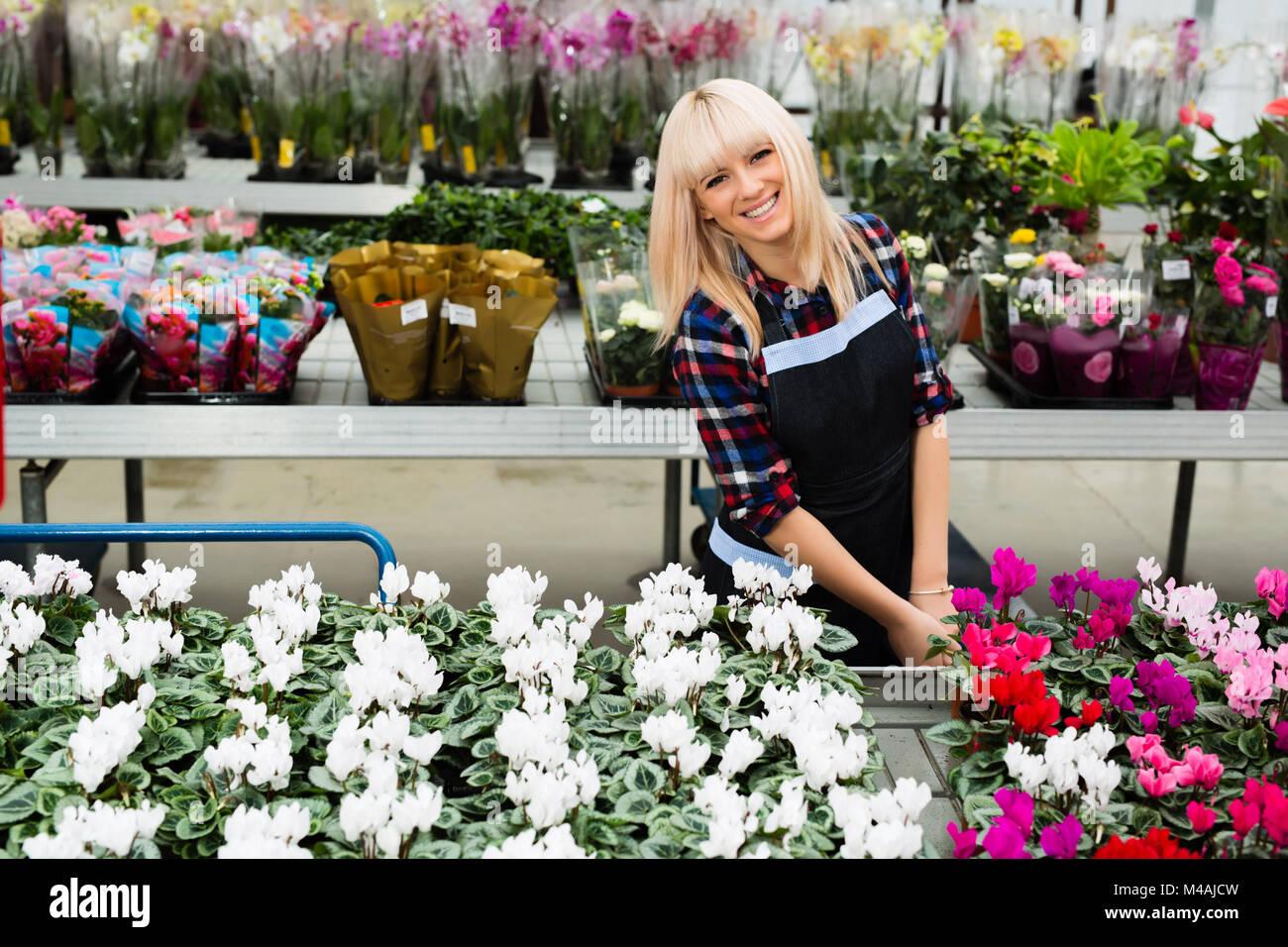 Beautiful flower shop seller stock photo royalty free image beautiful flower shop seller izmirmasajfo Gallery